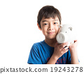 Little boy take a saving money in piggy bank 19243278