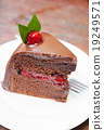 Piece of chocolate cake on white plate 19249571