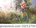 Flower decoration on white bicycle  19252794
