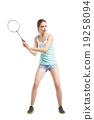 beautiful girl playing with badminton racket  19258094
