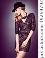 Fashion portrait woman,sequins dress and black hat 19259792