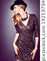 Fashion portrait woman,sequins dress and black hat 19259794