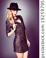 Fashion portrait woman,sequins dress and black hat 19259795