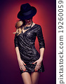 Fashion portrait woman,sequins dress black hat red 19260059