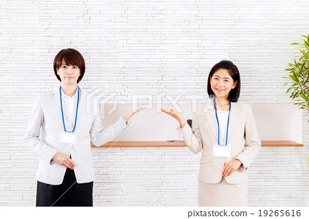 Business recommendation 2 women at reception desk 19265616