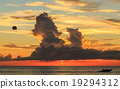 Parasailing and beautiful sunset over the sea in Phuket 19294312