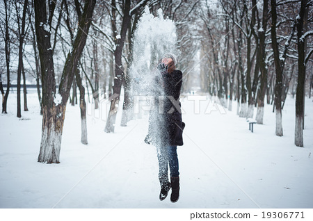 Young redhead woman in winter park 19306771