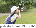 Girls blowing soap bubbles 19309165