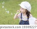Girls blowing soap bubbles 19309227