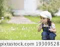 Girls blowing soap bubbles 19309528