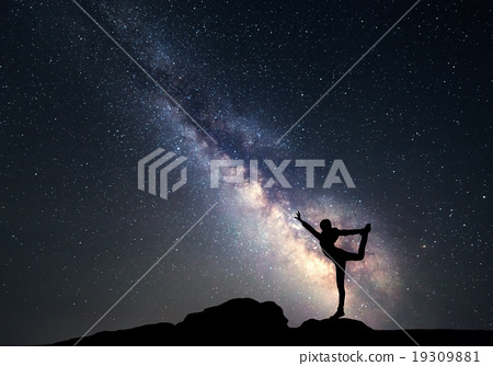 Milky Way and silhouette of a sporty woman 19309881