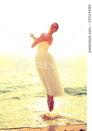 ballerina dancing on the coast at sunset 19324084