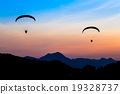 Paramotor flying in the sky 19328737