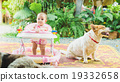 6 months baby feeling happy and smiles with dog 19332658