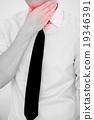 Man Having painful Sore Throat. Touching neck.  19346391