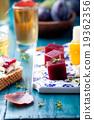 Crostini, bruschetta with plum and goat cheese 19362356