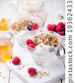 Healthy breakfast Granola with honey, yogurt 19362433