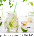 Lemonade with ice, lemon and lime slices in jar 19362445
