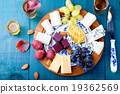 Cheese plate with fresh grape, honey, plum jelly 19362569