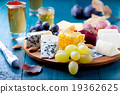 Cheese plate with fresh grape, honey, plum jelly 19362625