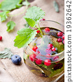Herbal tea with fresh berries. Romantic background 19362642