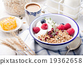 Healthy breakfast Granola honey, yogurt 19362658