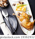 Duck legs confit with potato gratin 19362932