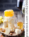 Grape, cheese, figs and honey with a glasses wine. 19362966