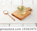 Sugar syrup in glass bowl on a white background 19362975