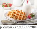 Fresh waffles, bottle of milk Breakfast table 19362988