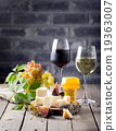 Grape, cheese, figs and honey with a glasses wine. 19363007