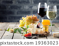 Grape, cheese, figs and honey with a glasses wine. 19363023