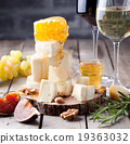 Grape, cheese, figs and honey with a glasses wine. 19363032