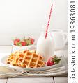 Fresh waffles, bottle of milk Breakfast table 19363081