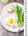 Green asparagus,fried egg and bread with butter. 19363082