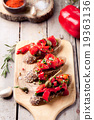 Italian bruschetta, crostini with roasted peppers 19363136