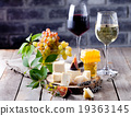 Grape, cheese, figs and honey with a glasses wine. 19363145