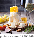 Grape, cheese, figs and honey with a glasses wine. 19363246