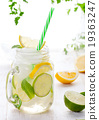 Lemonade with ice, lemon and lime slices in jar 19363247
