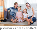Relaxed family in domestic interior 19364674