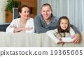 Smiling family in domestic interior 19365665