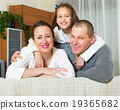 Happy family in domestic interior 19365682