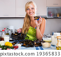 Housewife stuffing mollusc shells 19365833