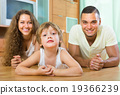 Happy couple with child at home 19366239