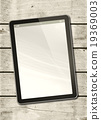 Digital tablet PC on a white wood table 19369003