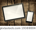 Smartphone and digital tablet PC on dark wood 19369004