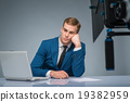 Newsman looking bored and weary. 19382959