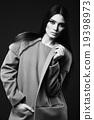 Woman in fashionable coat 19398973