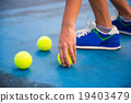 Athletes keep the tennis ball on a tennis court 19403479