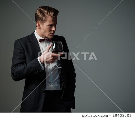 Sharp dressed man wearing jacket and bow tie 19408302